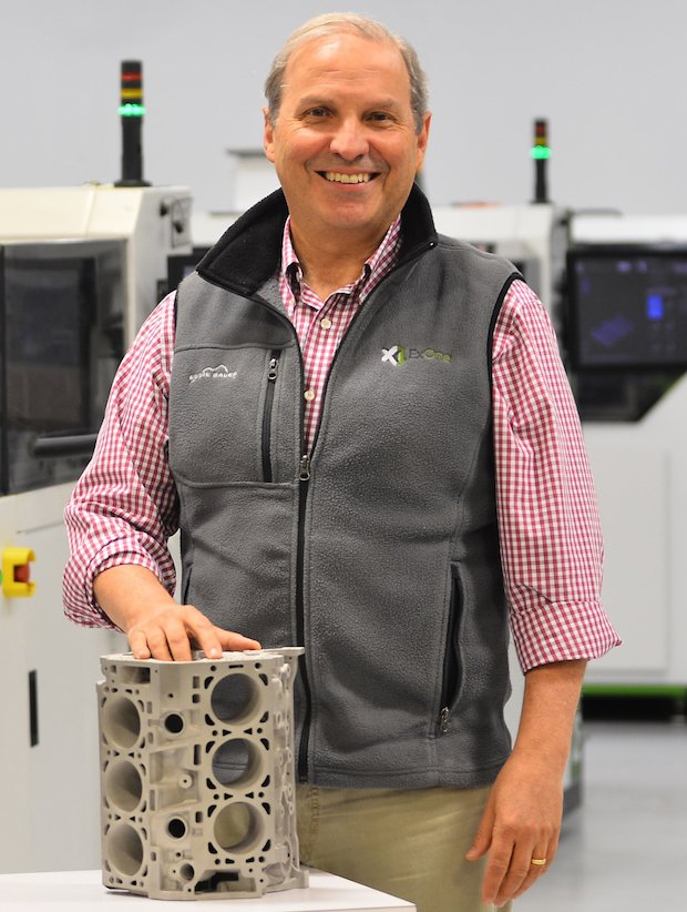 ExOne CEO John Hartner with engine block.jpg