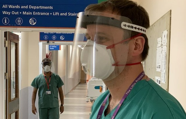 3D printed face shield worn by Stuart Smith, Consultant at Queen's Medical Centre, Nottingham, and Clinical Associate Professor at the University of Nottingham.jpeg