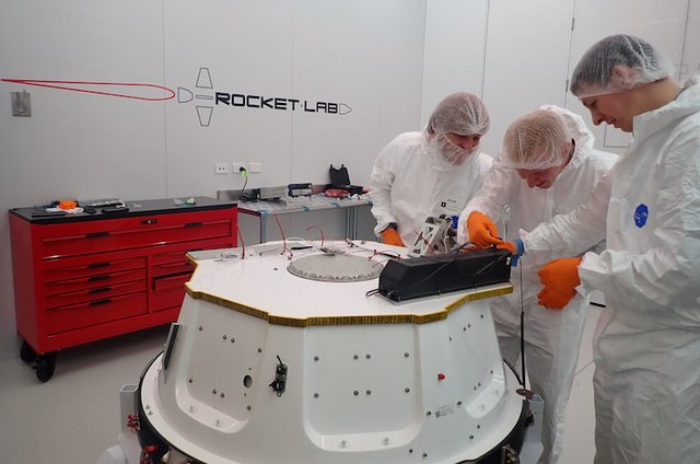 6.The first of the two fully loaded AlbaPod 2.0 being attached to the kick stage of Rocket Labs Electron rockets for launch. Courtesy of Alba Orbital.png
