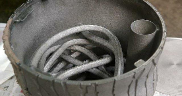 GE Additive 3D printed feeder.jpg