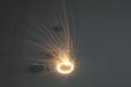 Laser melting circular parts darker
