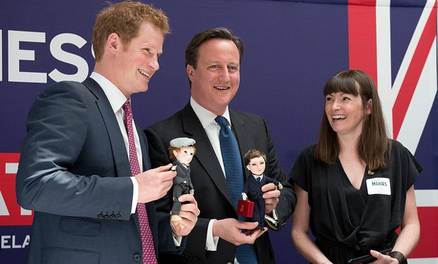 MakieLab's Jo Roach presents Harry and David Cameron with their Makie dolls