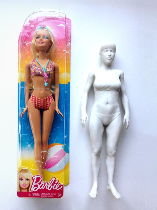 3D printed Barbie next to a pre-packed Barbie