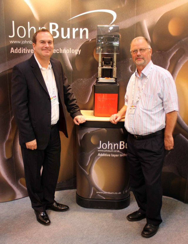 Brian Lang of John Burn and Peter Hansford of EnvisionTEC seal the deal
