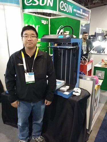 ToyBuilder Labs Co-Founder joseph Chiu next to the large ideaPrinter F100L