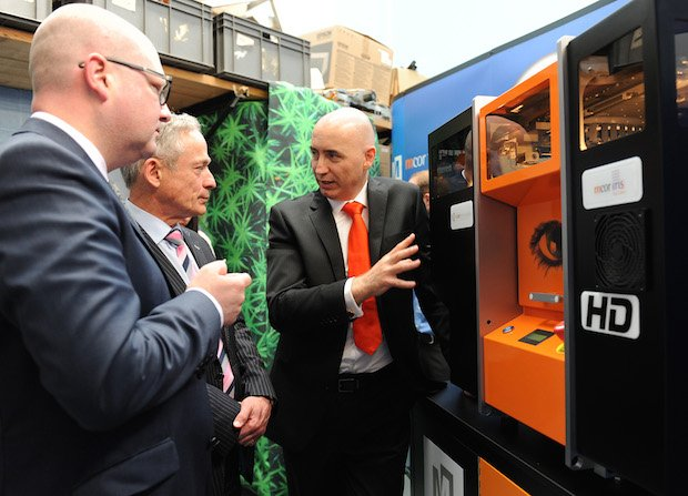 Conor showcases Mcor's technology to Ministers Nash (Left) and Bruton (Centre).jpg