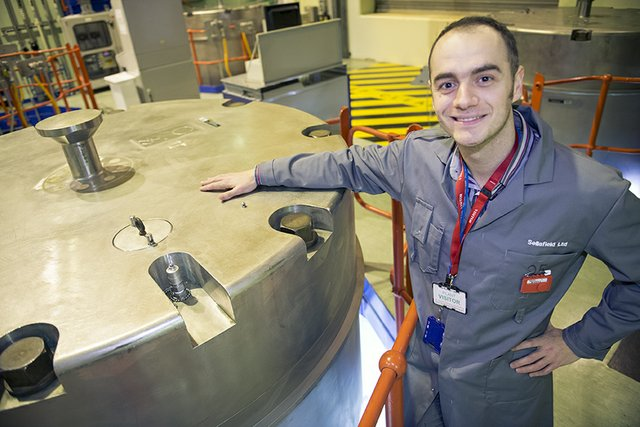 Lead Mechanical Engineer, Eduard Bordas and the container lid