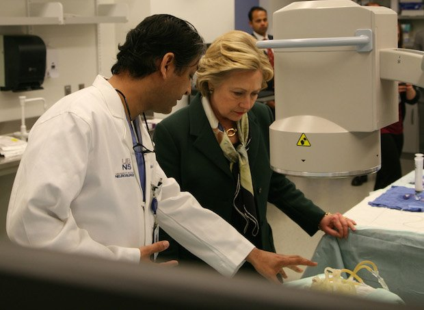 Hillary Clinton with Dr. Adnan H. Siddiqui, Chief Medical Officer, The Jacobs Institute.jpg