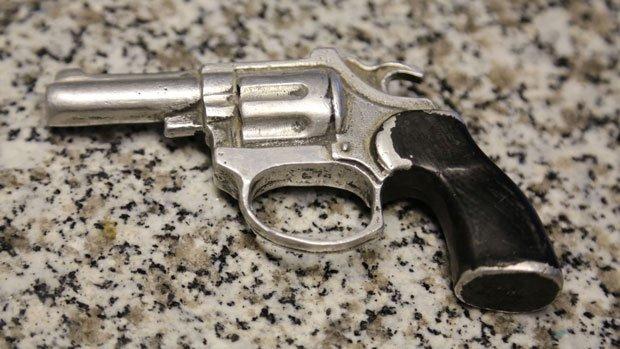 Metal gun cast from a toy water pistol