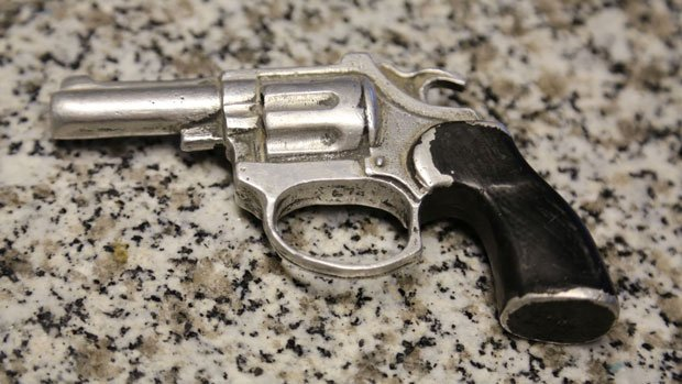 Metal gun cast from a toy water pistol